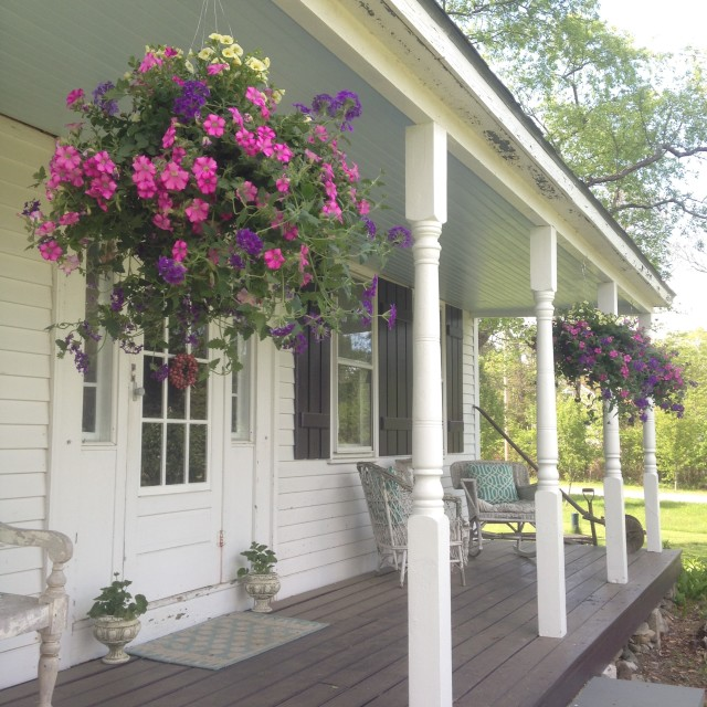 tiny-farmhouse-porch-with-hanging-baskets | tiny farmhouse