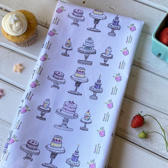 100% cotton, eco-friendly tea towel / kitchen towel with cute, hand drawn cakes and cupcakes pattern
