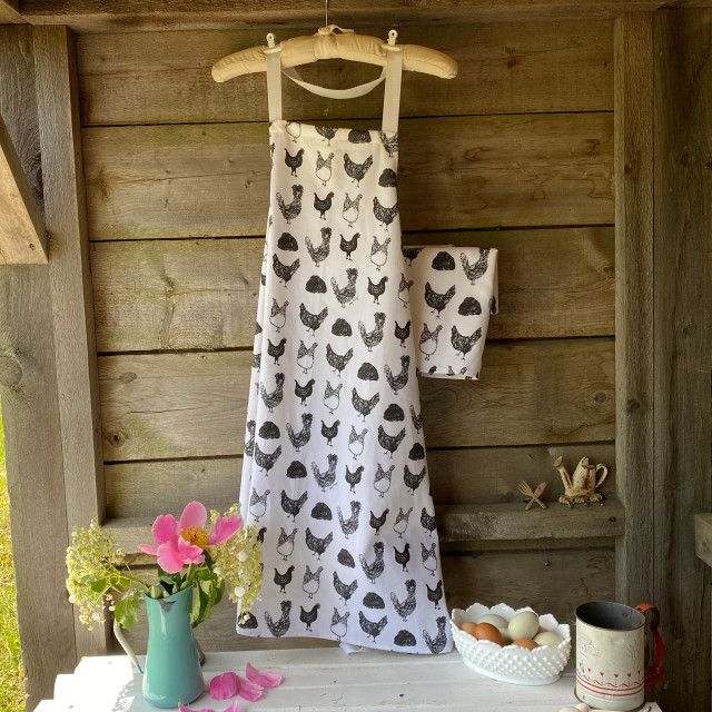100% cotton, eco-friendly tea towel / kitchen towel and apron with fun, black and white chicken pattern
